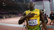 Jamaica&#39;s Usain Bolt reacts as he wins the men&#39;s 100m final during the London 2012 Olympic Games at the Olympic Stadium August 5, 2012 (Reuters)