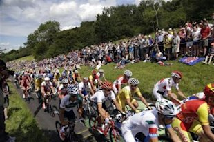 Cyclists pedal along Box Hill during the Men's Road Cycling race at the 2012 Summer Olympics, Saturday, July 28, 2012, in London. Alexander Vinokourov