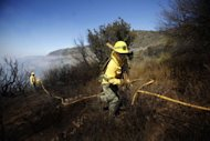 Members of the Forest Brigade are deployed to fight a fire on the Erque ravine in the town of Vallehermoso on the Spanish Canary island of La Palma