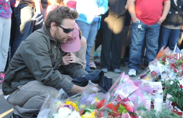 Fans pay their respects at the site of the car accident in which actor Paul Walker was killed in Santa Clarita, California, on December 1, 2013