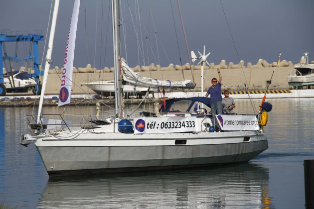 "Women's rights activists sail a small boat around a yacht harbor in Smir, northern Morocco on Thursday Oct 4 2012 to raise awareness about safe abortions, despite officials' efforts to seal the port and anti-abortion protests on land. Organizers had initially said a large ship offering abortion information and services was on its way from the Netherlands on Thursday. In response, police sealed the port for what it called ""military maneuvers"" and denied journalists access. But in the afternoon, organizers admitted that they already had stationed a sailboat in the port several days ago, fearing that authorities would close the port. And that sailboat took off around the harbor bearing banners. Meanwhile, on land, about 200 protesters targeted the activists from ""Women on Waves,"" the Dutch organization behind the boat. (AP Photo/Paul Schemm)."