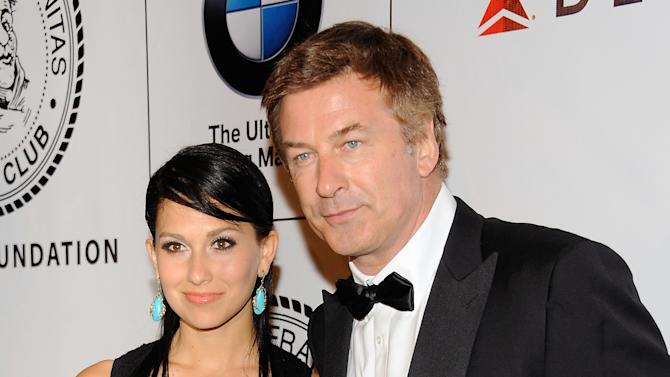 """FILE - This June 12, 2012 file photo shows actor Alec Baldwin and his fiancee Hilaria Thomas at The Friars Club and Friars Foundation Honor of Tom Cruise at The Waldorf-Astoria in New York. A New York City news photographer says he was punched by Alec Baldwin outside a marriage license bureau in Manhattan. The Daily News reports that Marcus Santos was snapping images of the """"30 Rock"""" star with his fiancée Hilaria Thomas Tuesday, June 19. Santos told the paper that Baldwin grabbed a second news photographer, then started shoving Santos and hit him in the chin. He then walked away. Photos on the newspaper's website appear to show Baldwin shoving the photographer. No police report has been filed. A call to the newspaper's public relations office wasn't returned.  (Photo by Evan Agostini/Invision/AP, file)"""