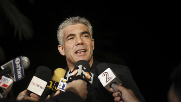 Yair Lapid, leader of Yesh Atid party gives a statement outside his home in Tel Aviv, Wednesday, Jan. 23, 2013. Yesh Atid, or There is a Future, party, turned pre-election forecasts on their heads and dealt Israeli Prime Minster Benjamin Netanyahu a sharp political blow. (AP Photo/Ariel Schalit)