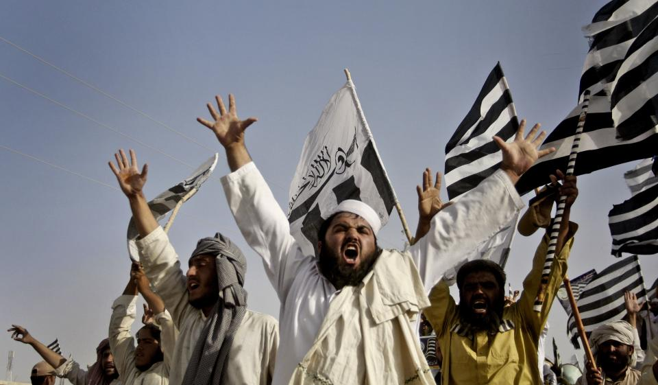 Supporters of Defense Council of Pakistan, a coalition of hard line Islamist religious parties and politicians, shout slogans during a rally condemning the movement of NATO supplies to Afghanistan through Pakistan, in Chaman, a Pakistani town along Afghan border, Sunday, July 15, 2012. (AP Photo/Matiullah Achakzai)