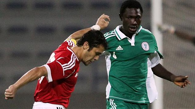 Nigeria's Reuben Gabriel (R) challenges Egypt's Ahmed Hassan during their friendly football match (AFP)