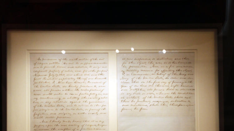 "FILE - This Feb. 9, 2009 file photo shows the first draft of President Abraham Lincoln's Emancipation Proclamation that Lincoln presented to his full cabinet on July 22, 1862, displayed at the Library of Congress in Washington. As New Year's Day approached 150 years ago, all eyes were on President Abraham Lincoln in expectation of what he warned 100 days earlier would be coming _ his final proclamation declaring all slaves in states rebelling against the Union to be ""forever free.""A tradition began on Dec. 31, 1862, as many black churches held Watch Night services, awaiting word that Lincoln's Emancipation Proclamation would take effect as the country was in the midst of a bloody Civil War. Later, congregations listened as the president's historic words were read aloud. (AP Photo/Pablo Martinez Monsivais, File)"