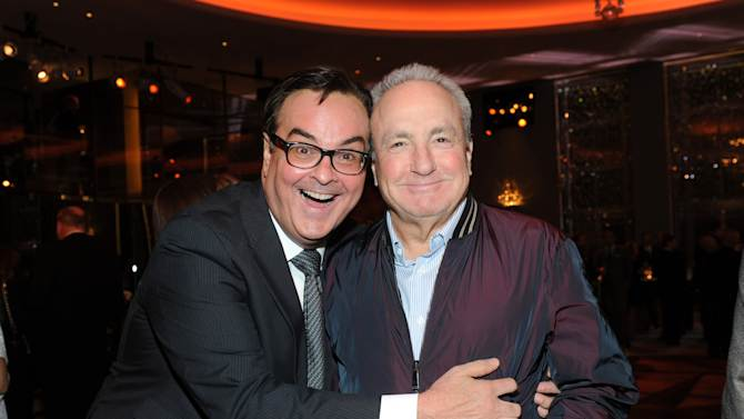 IMAGE DISTRIBUTED FOR TISHMAN SPEYER - The Tonight Show announcer Steve Higgins, left, and producer Lorne Michaels enjoy the opening of the historic Rainbow Room at 30 Rockefeller Plaza, Wednesday, Oct. 1, 2014 in New York. (Photo by Diane Bondareff/Invision for Tishman Speyer/AP Images)