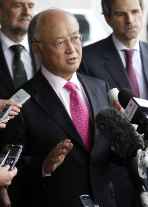 "Director General of the International Atomic Energy Agency, IAEA, Yukiya Amano from Japan speaks to the media after returning from Iran at the Vienna International Airport near Schwechat, Austria, on Tuesday, May 22, 2012. Amano says he has reached a deal with Iran on probing suspected work on nuclear weapons and adds that the agreement will ""be signed quite soon."" (AP Photo/Ronald Zak)"