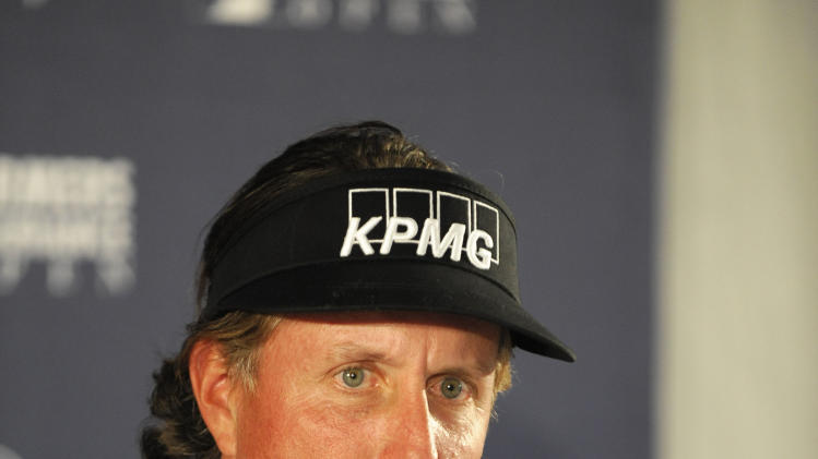 Golfer Phil Mickelson answers a question about comments he made about taxes during a news conference held after his round in the pro-am at the Farmers Insurance Open golf tournament at Torrey Pines Wednesday, Jan 23, 2013, in San Diego.  (AP Photo/Denis Poroy)