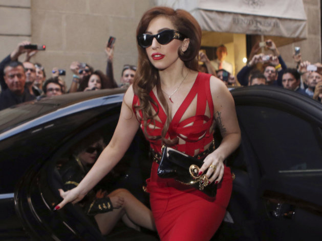 FILE - This Oct. 1, 2012 file photo shows Lady Gaga arriving at the Versace atelier in Milan, Italy. A person familiar with the inauguration tells The Associated Press that the pop star will perform at Tuesday&#39;s ball for White House staffers. The source spoke on condition of anonymity because that person wasn&#39;t authorized to publicly reveal the information. (AP Photo/Luca Bruno, File)