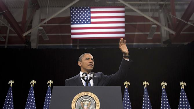 President Barack Obama waves as he arrives to speak about immigration at Del Sol High School, Tuesday, Jan. 29, 2013, in Las Vegas. (AP Photo/Carolyn Kaster)
