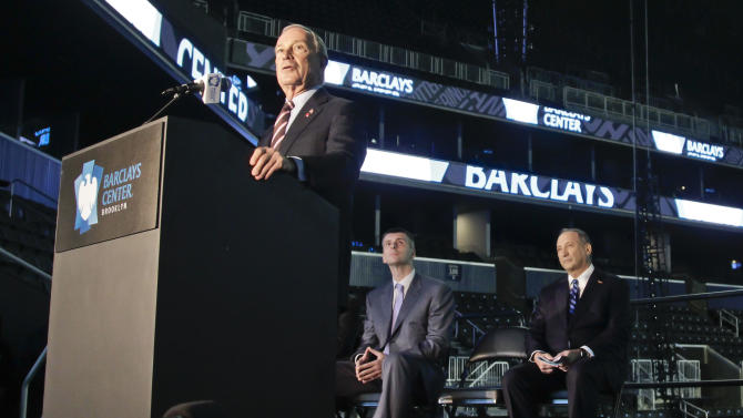 New York Mayor Michael Bloomberg speaks during a a ribbon cutting ceremony at Brooklyn's Barclays  Center on Friday, Sept. 21, 2012, as Brooklyn Nets owner Mikhail Prokhorov, center, and Forest City Ratner Companies Chairman and CEO Bruce Ratner, right, look on. After decades without a professional sports team, New York City's ascendant borough hit the major leagues again on Friday with the opening of the Brooklyn Nets' new arena.  (AP Photo/Bebeto Matthews)