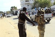 AMISOM (African Union Mission in Somalia) patrol the area of a bomb blast, claimed by Islamist rebels, that rocked the Mogadishu hotel on September 12. Somalia's new president has been moved to a secure compound after surviving an assassination bid that dented hopes of change in the violence-scarred country and brought condemnation from the United States