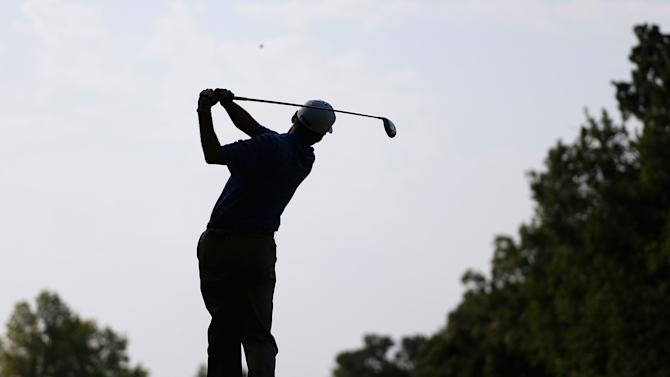 Kevin Sutherland hits a tee shot at Oak Tree National in Edmond, Oklahoma, on July 10, 2014