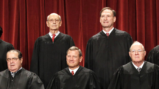 FILE - In this Oct. 8, 2010, file photo U.S. Supreme Court justices pose for a photo at the Supreme Court in Washington. Four Republican-appointed justices, front row from left, Antonin Scalia, Chief Justice John Roberts, Anthony M. Kennedy and top right, Samuel Alito Jr., control the fate of President Barack Obama's health care overhaul. For the law to stand only one of the four needs to decide that it, and its centerpiece of requiring almost every American to buy insurance or pay a penalty, passes constitutional muster. At top left is Justice Stephen Breyer.  (AP Photo/Pablo Martinez Monsivais, File)