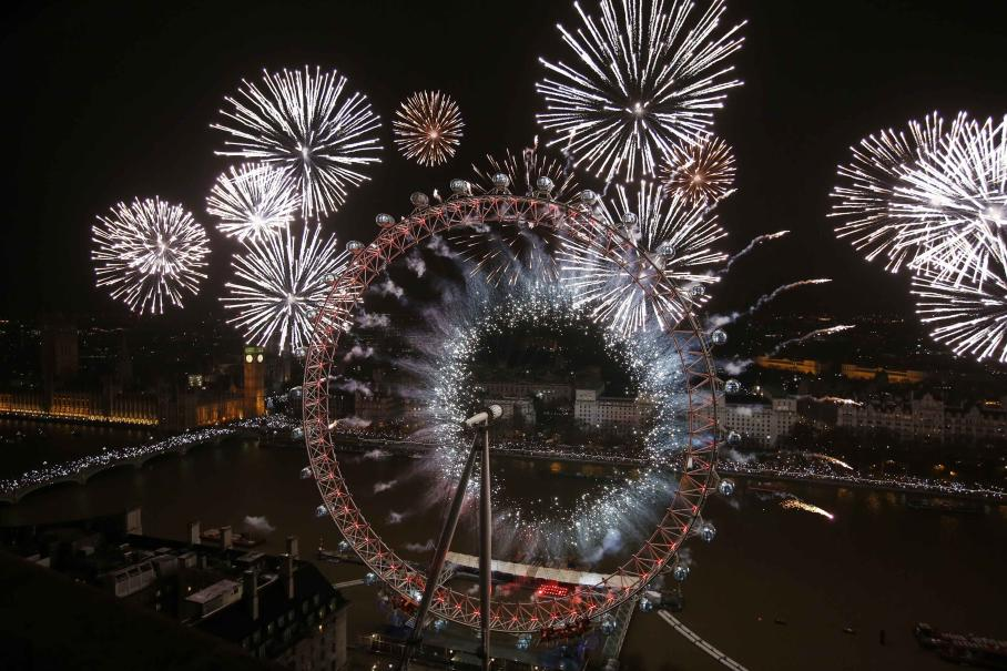Fireworks explode across a London skyline near the London Eye during New Year celebrations in London