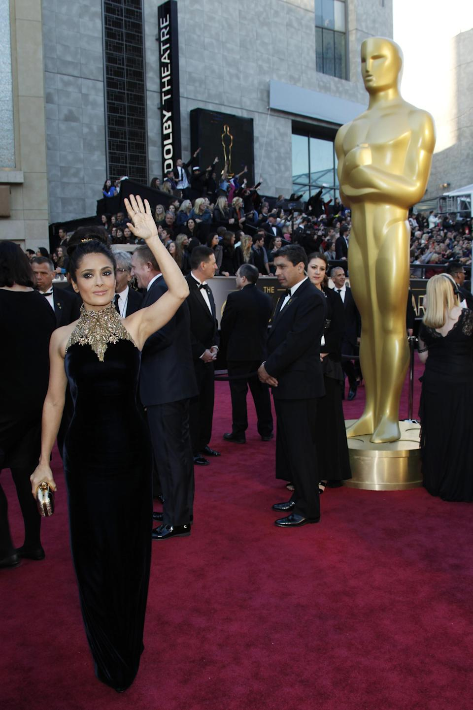 Actress Salma Hayek arrives at the Oscars at the Dolby Theatre on Sunday Feb. 24, 2013, in Los Angeles. (Photo by Carlo Allegri/Invision/AP)