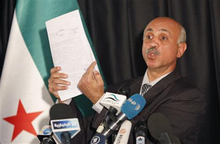 Abdeltawwab Shahrour, head of the forensic medicine committee in Aleppo, shows forensic reports, during a news conference in Istanbul