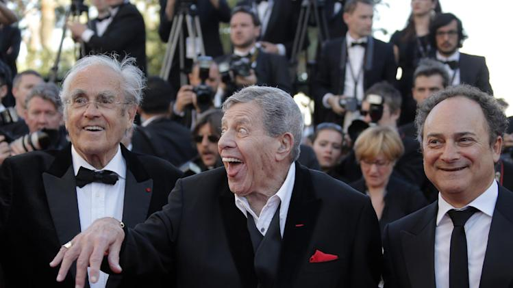 From left, Michel Legrand, comedian Jerry Lewis and actor Kevin Pollak arrive for the screening of Nebraska at the 66th international film festival, in Cannes, southern France, Thursday, May 23, 2013. (AP Photo/Francois Mori)
