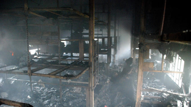 A totally charred coach from inside is seen of a passenger train at Nellor nearly 500 kilometers (310 miles) south of Hyderabad, India, Monday, July 30, 2012. A fire swept through a train car packed with sleeping passengers in southern India on Monday, killing at least 47 people and sending panicked survivors rushing for the only clear exit once the train stopped, officials said. (AP Photo)