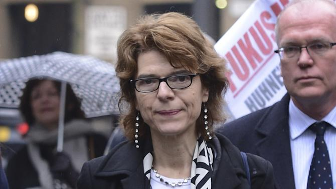 Vicky Pryce, former wife of former British cabinet minister  Chris Huhne, arrives at Southwark Crown Court in London Thursday March 7, 2013. Pryce was convicted on Thursday of perverting the course of justice for taking her husband's speeding penalty in 2003. Pryce  had claimed that her husband, Chris Huhne, coerced her into taking the penalty for the speeding violation — will be sentenced at a later date alongside her ex, who earlier pleaded guilty to the same charge. (AP Photo/ Stefan Rousseau/PA) UNITED KINGDOM OUT