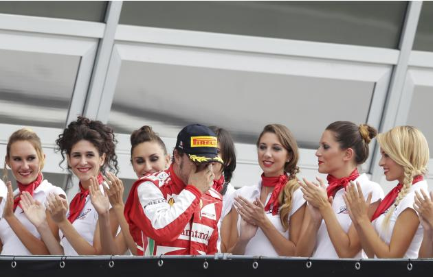 Ferrari Formula One driver Alonso arrives on the podium after placing second in the Italian F1 Grand Prix at the Monza circuit