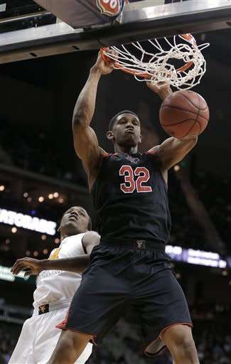 Texas Tech tips West Virginia 71-69 in Big 12