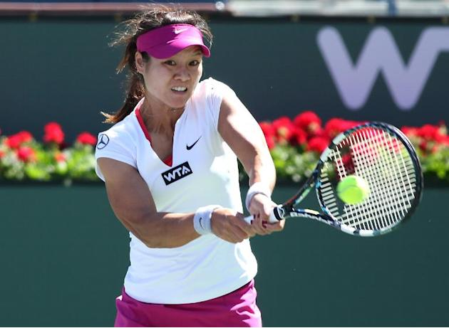 Li Na of China hits a return to Zheng Jie of China during the BNP Paribas Open at Indian Wells Tennis Garden on March 8, 2014 in Indian Wells, California