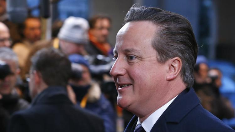 Britain's PM Cameron arrives at European Union leaders summit at EU council headquarters in Brussels