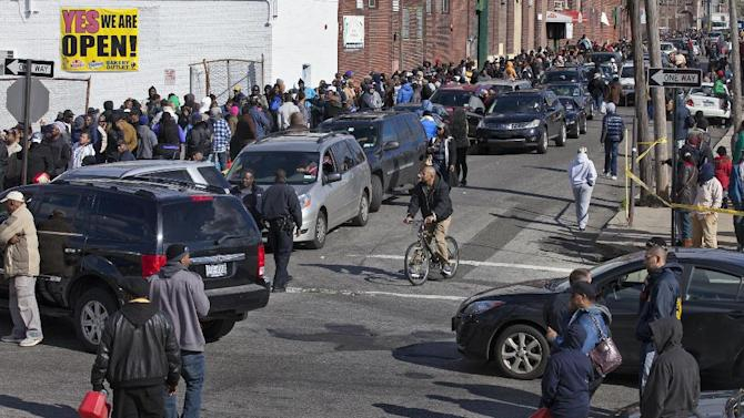 People in cars and on foot line up for free gas in the Jamaica neighborhood of the Queens borough of New York, Saturday, Nov. 3, 2012, in the wake of Superstorm Sandy. Trucks provided by the U.S. Department of Defense at the direction of President Barack Obama at this site and others were deployed in coordination with the New York National Guard at the direction of the governor. (AP Photo/Craig Ruttle)