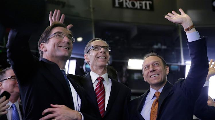 Sabre Corp. President & CEO Tom Klein, right, and company CFO Rick Simonson, center, are joined by Nasdaq CEO Robert Greifeld as they wait for Sabre's IPO to begin trading, at the Nasdaq MarketSite, in New York, Thursday, April 17, 2014. (AP Photo/Richard Drew)