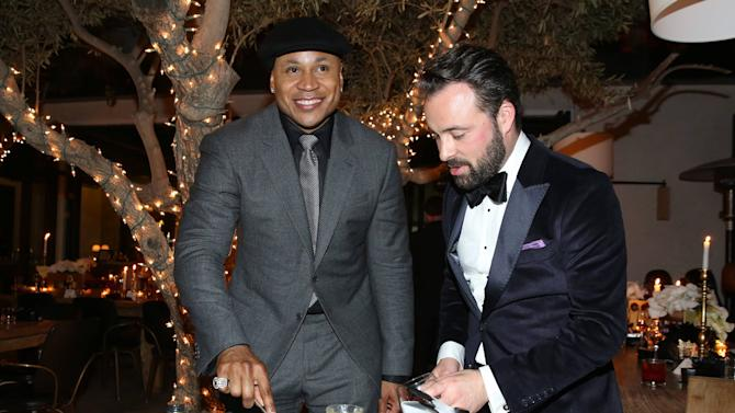 IMAGE DISTRIBUTED FOR HENNESSY - Host of the 58th Annual GRAMMY Awards LL Cool J, left accompanies Hennessy National Brand Ambassador Jordan Bushell in creating a Frozen Apricot Sidecar at the Hennessy V.S.O.P Privilege pre-GRAMMY dinner at Ysabel on Saturday, Feb. 13, 2016 in Los Angeles. (Photo by Matt Sayles/Invision for Hennessy/AP Images)