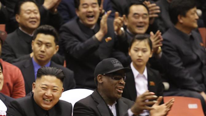 North Korean leader Kim Jong Un, left, and former NBA star Dennis Rodman watch North Korean and U.S. players in an exhibition basketball game at an arena in Pyongyang, North Korea, Thursday, Feb. 28, 2013. Rodman arrived in Pyongyang on Monday with three members of the Harlem Globetrotters basketball team to shoot an episode on North Korea for a new weekly HBO series. (AP Photo/VICE Media, Jason Mojica)
