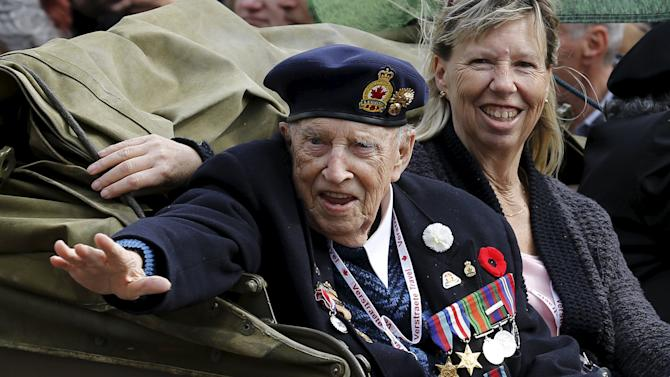 A Canadian veteran waves during a parade marking the 70th anniversary of the liberation of the Netherlands in Wageningen