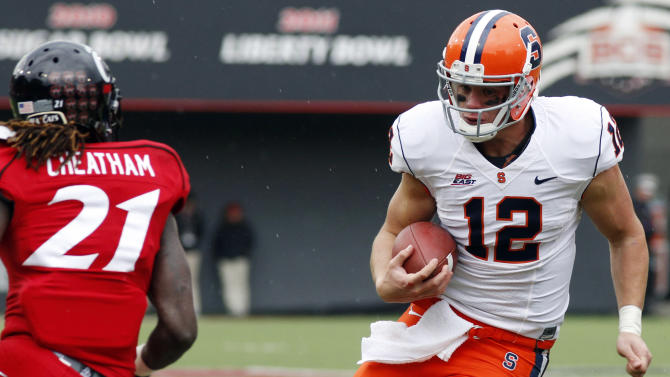 FILE -In this Nov. 13, 2012, file photo, Syracuse quarterback Ryan Nassib (12) runs for a gain against Cincinnati defensive back Camerron Cheatham (21) during the second quarter of an NCAA college football game at Nippert Stadium in Cincinnati. Nassib was drafted by the New York Giants in the fourth round of the NFL Draft on Saturday, April 27, 2013.(AP Photo/David Kohl, File)