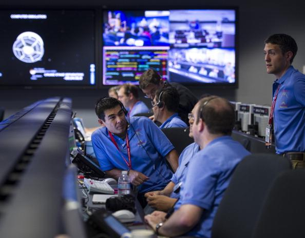 In this handout image provided by NASA, Mars Science Laboratory (MSL) team members gather in the MSL Mission Support Area at the Jet Propulsion Laboratory hours ahead of the planned landing of the Cur