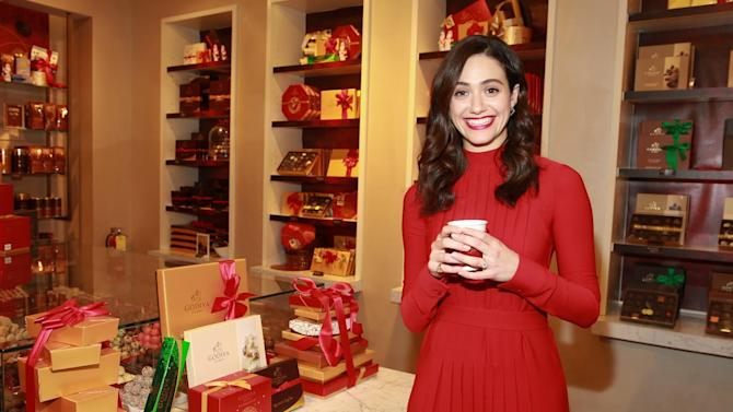 "IMAGE DISTRIBUTED FOR GODIVA - Emmy Rossum seen at the GODIVA store to celebrate the Launch of GODIVA and Toys for Tots ""Hot Chocolate for a Cause"" Program on Monday, Nov. 30, 2015 in New York. (Photo by Amy Sussman/Invision for GODIVA/AP Images)"