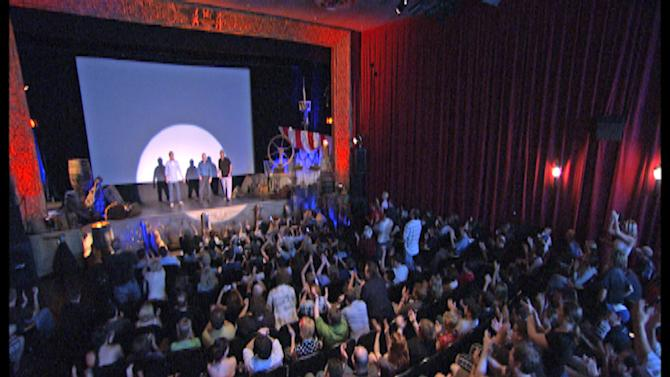 "This Aug. 17, 2011 photo provided by producer Josh Gemma shows RiffTrax members,  from left: Michael J. Nelson, Bill Corbett and Kevin Murphy crack wise on stage during a screening of the 1962 movie ""Jack the Giant Killer"" at a Nashville, Tenn.  More than a decade after the demise of cult TV show  ""Mystery Science Theater 3000,"" comedy groups are riffing on bad movies at theaters, nightclubs and sports arenas across the country. (AP Photo/RiffTrax)"
