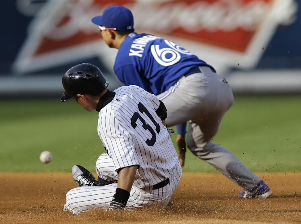 New York Yankees' Ichiro Suzuki (31) is safe on a fourth-inning double as Toronto Blue Jays shortstop Munenori Kawasaki (66) loses control of the ball during a baseball game at Yankee Stadium, Thursday, Aug. 22, 2013, in New York. (AP Photo/Kathy Willens)
