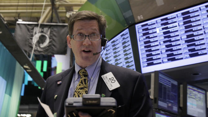 Trader Christopher Forbes works on the floor of the New York Stock Exchange Wednesday, Oct. 24, 2012. Stocks are opening higher on Wall Street, following a big drop the day before, after big companies including Boeing reported stronger profits. (AP Photo/Richard Drew)