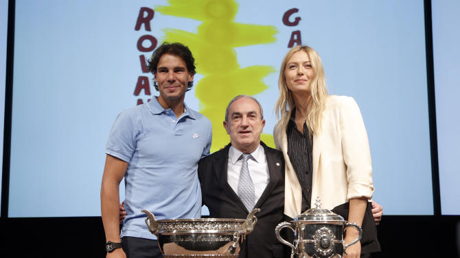Spain's Rafael Nadal, left, Head of the French Tennis Federation, Jean Gachassin, center, and Russia's Maria Sharapova pose during the draw for the 2013 French Open tennis tournament, at Roland Garros stadium in Paris, Friday May, 24, 2013. (AP Photo/Christophe Ena)