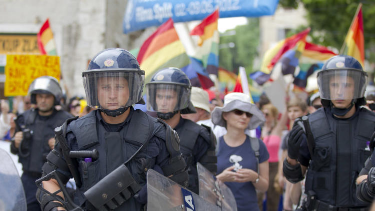 Riot police secure gay rights activists during a Gay Pride march in Split, Croatia, Saturday, June 9, 2012. (AP Photo/Nikola Solic)