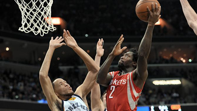 Houston Rockets guard Patrick Beverley (2) shoots against Memphis Grizzlies forward Tayshaun Prince (21) during the first half of an NBA basketball game Friday, Dec. 26, 2014, in Memphis, Tenn. (AP Photo/Brandon Dill)