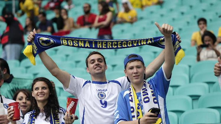 Bosnia fans cheer before the group F World Cup soccer match between Bosnia and Iran at the Arena Fonte Nova in Salvador, Brazil, Wednesday, June 25, 2014. (AP Photo/Marcio Jose Sanchez)