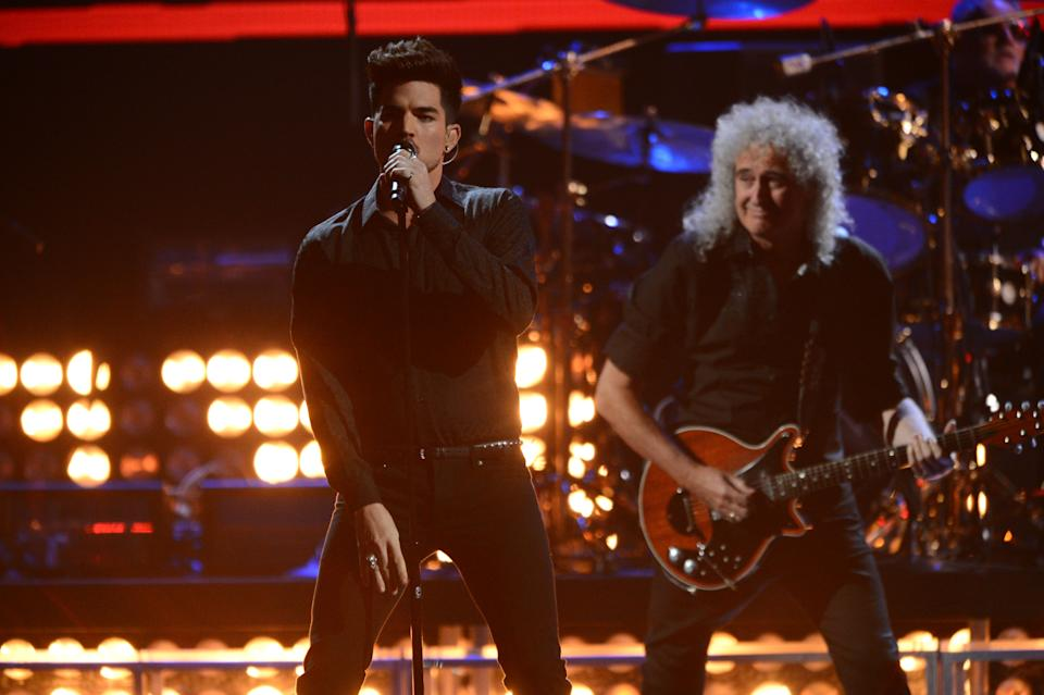 This Sept. 20, 2013 photo shows Adam Lambert, left, and Brian May of Queen performing at the iHeartRadio Music Festival in Las Vegas, Nev. (Photo by Al Powers/Powers Imagery/Invision/AP)