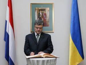 Ukraine's President Poroshenko signs a book of condolence as he commemorates victims of Malaysia Airlines Flight MH17 at the Dutch embassy in Kiev