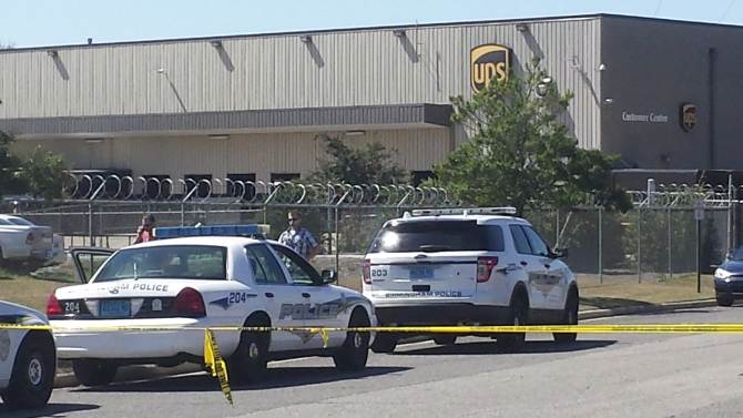 Police vehicles are seen outside a UPS service center following a deadly shooting in Birmingham, Alabama
