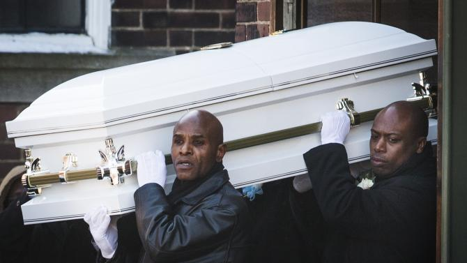 Pallbearers carry the casket of three-year-old Elijah Marsh following his funeral in Toronto