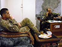 In this March 25, 2013, photo, U.S. Marine Lt. Col. Philip Treglia and Brig. Gen. Mohammad Ali Sujai drink tea in one of their near-daily meetings at the Afghan national army's 1st Brigade, 215th Corps headquarters at Camp Garmser, Helmand province, Afghanistan. Treglia leads the U.S. Security Forces Advise and Assist Team guiding the Afghans as they transition to independent operations ahead of the December 2014 deadline for the drawdown of most NATO troops. U.S. commanders trying to hand off war-fighting responsibility by the end of 2014 are encouraged by the uneven yet steady progress of fledgling Afghan security forces. (AP Photo/Kim Dozier)