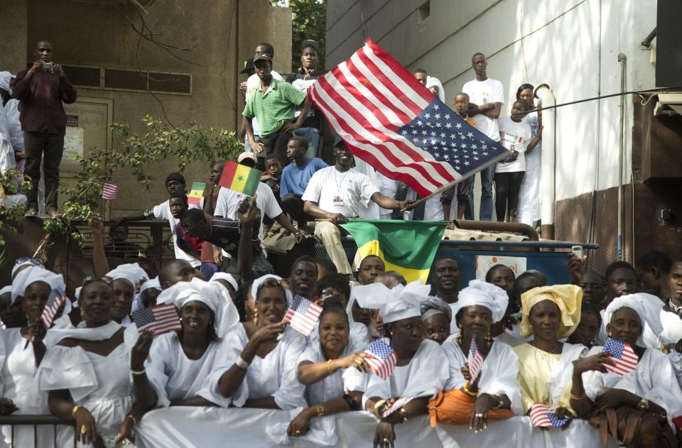 People line the motorcade route of U.S. President Barack Obama on his way to meet with Senegalese President Macky Sall at the Presidential Palace on Thursday, June 27, 2013, in Dakar, Senegal. Obama is visiting Senegal, South Africa, and Tanzania on a week long trip. (AP Photo/Evan Vucci)